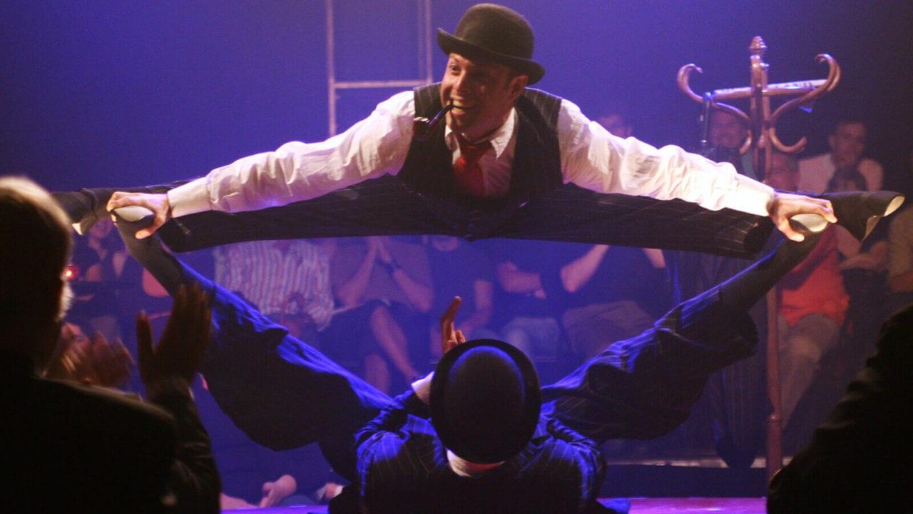 La Soirée gents doing splits production shot